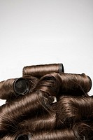 Hair in curlers, piled high