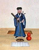 Taoist  Historical artwork of a Taoist  In front of him are an offering, a vase and a scripture  Taoism is an ancient Chinese religion and philosophic...