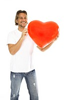 Man holding heart-shaped baloon, close-up