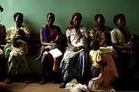 Hospital waiting room  Mothers and their children waiting to see a doctor at a hospital  Photographed in a rural area of the Gulu region of Uganda