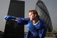 Boxer punching air downtown low angle view side view London England