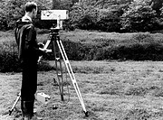 Mekometre surveying  Surveyor using a mekometre, an instrument used to measure long distances at extremely high resolution  This equipment is specific...