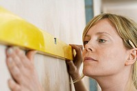 Woman using spirit level close_up