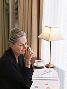Business woman sitting at desk elevated view (thumbnail)
