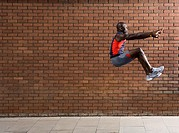 Man jumping by wall