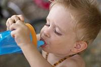 Little boy drinking from bottle