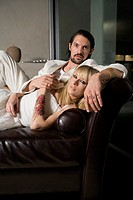 Newlywed Couple Lying Down on Sofa
