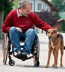 man in a wheelchair with dog