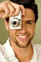 Portrait of a young man taking pictures