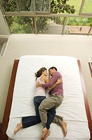 Couple sleeping in a bed, view from above, indoors (thumbnail)