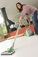 Woman vacuuming, indoors