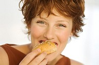 Portrait of a young woman eating bread