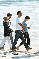 2 couples holding hands, walking on the beach (thumbnail)