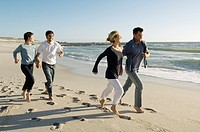 2 couples running on the beach