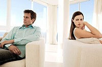 Couple sulking in living-room