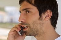 Portrait of a young man using mobile phone (thumbnail)