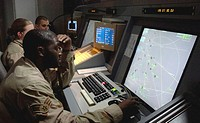 Senior Airman Sorie Bangura, 332nd Expeditionary Operation Support Squadron, controls the air space over Iraq May 15, 2006. The transportable radio ap...