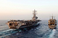 USS RONALD REAGAN (CVN 76), At sea (Mar. 28, 2007) - As the sun rises in the Western Pacific Ocean, USS Ronald Reagan (CVN 76) goes alongside USNS Kis...