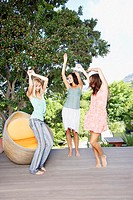 Friends dancing around on a deck