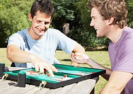 Friends playing backgammon