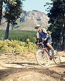 A man mountain biking on a trail (thumbnail)