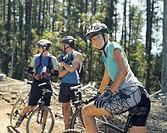 Three mountain bikers on a path