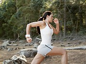A woman jogging in the woods