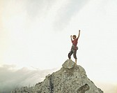A climber at the top of a mountain victorious