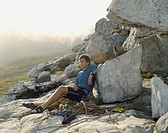 A mountain climber sitting down to rest