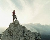 A mountain climber standing on top of a mountain
