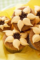 Orange nut muffins with orange cream & chocolate sprinkles