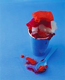 Sorbet in a paper cup against a blue background