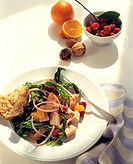 Spinach salad with ham, mandarins and raspberries