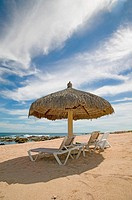 Beach chairs and umbrella, Cabo San Lucas, Mexico