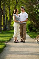 Couple standing on sidewalk