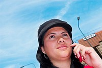 Low angle view of a young woman talking on a mobile phone