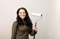 Woman posing with paint roller