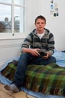 Teenage boy playing video game