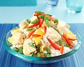 Rice salad with peppers, cooked curried chicken & mango wedges