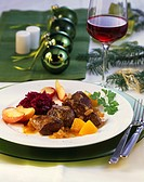 Venison goulash with peach sauce and caramelised apples