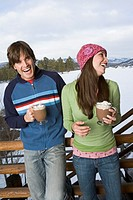 Laughing couple with hot cocoa