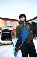 Man carrying snowboard