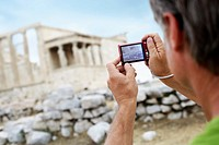 Man Photographing an Ancient Ruin