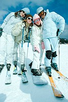 Group of teen girls in ski gear, full length portrait
