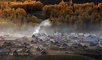 Cooking smoke rising above the frontier town of Womuk in Northwest Xinjiang, China
