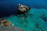 Dodecanese, Kastellorizo Strongili Islet coast woman snorkeling, swimming
