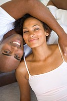 Couple embracing, smiling, portrait, overhead view