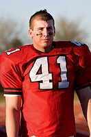 American football player wearing red football strip with number &#212;&#199;&#255;41&#212;&#199;&#214;, standing on pitch, front view