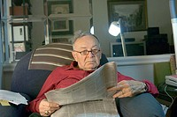 Dov Sachter reading paper. 87 years old