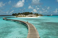 Board walk guiding to bungalows. Coco palm Bodu Hithi Island Resort & spa.(North Male Atoll in Maldives), Indian Ocean